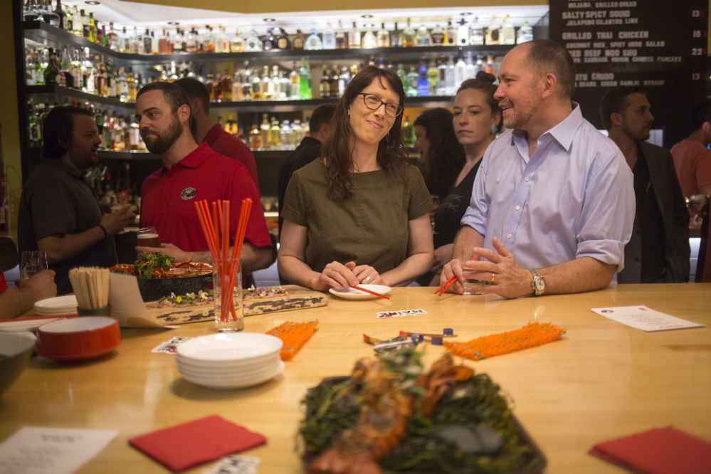 "From left, lobsterman Dave Laliberte, San Francisco restaurateur Nicole Krasinski, and Chicago chef Giuseppe Tentori attend the ""Maine After Midnight"" event hosted by the Maine Lobster Marketing Collaborative at The Honey Paw last month in Portland. The event allows networking opportunities meant to promote the placement of new-shell lobsters on menus far and wide."