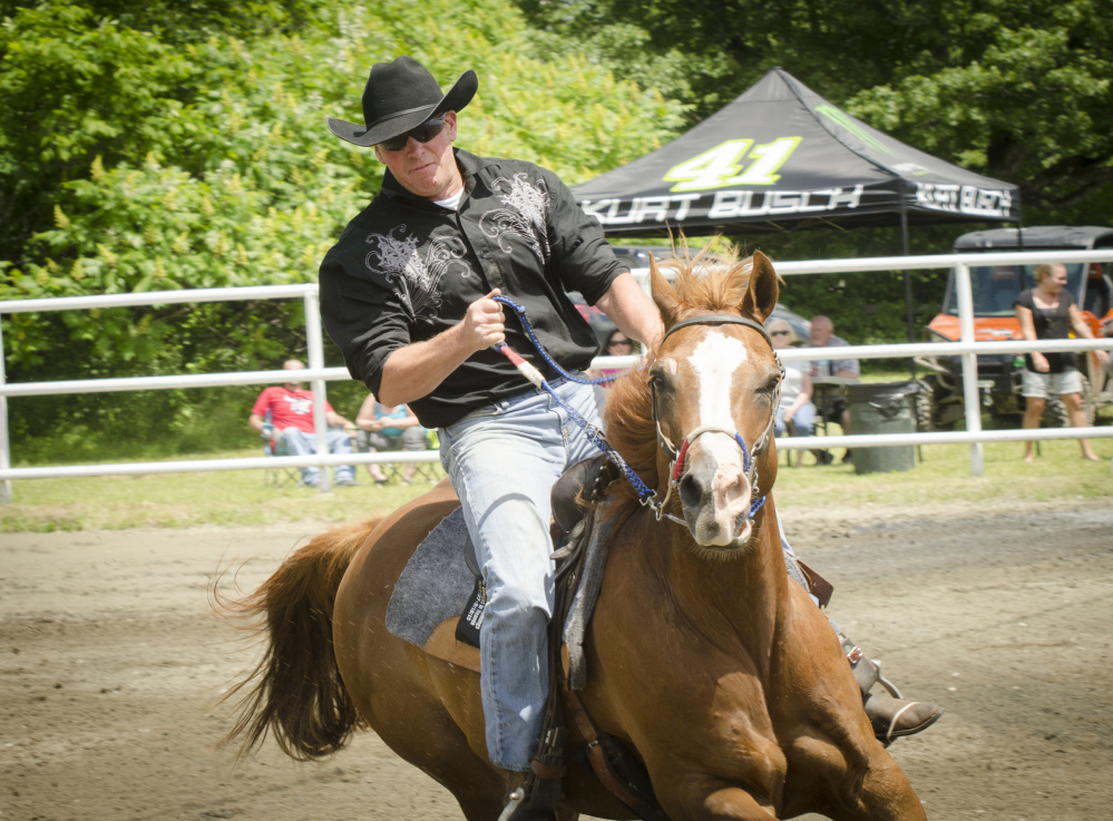 Hardy Cummings rides his horse at the Halee Lynn Cummings Memorial Barrel Race at the Silver Spur Riding Club in Sidney on Sunday to honor his late daughter.