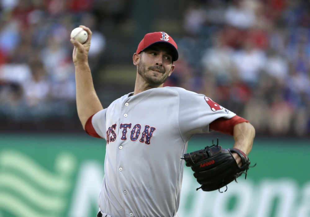 Red Sox starter Rick Porcello throws in the first inning. He pitched into the seventh inning but didn't get a decision as the game went 11 innings.