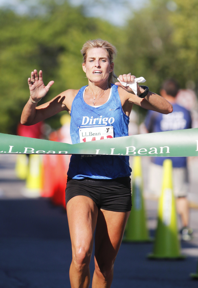 Sheri Piers of Falmouth is the first women's finisher in the L.L. Bean Fourth of July 10K on Tuesday in Freeport. Piers finished in 37:54.