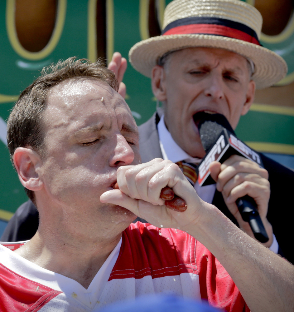 """Joey """"Jaws"""" Chestnut chomps his way to win Nathan's hot dog eating contest again Tuesday in New York."""