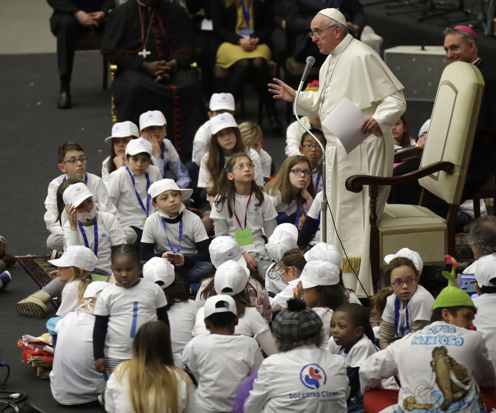 Pope Francis is surrounded by children as he speaks with patients and caregivers from the Vatican's Bambino Gesu Pediatric Hospital last December. A Vatican-commissioned report in 2014 spotlighted breaches of accepted medical practices.