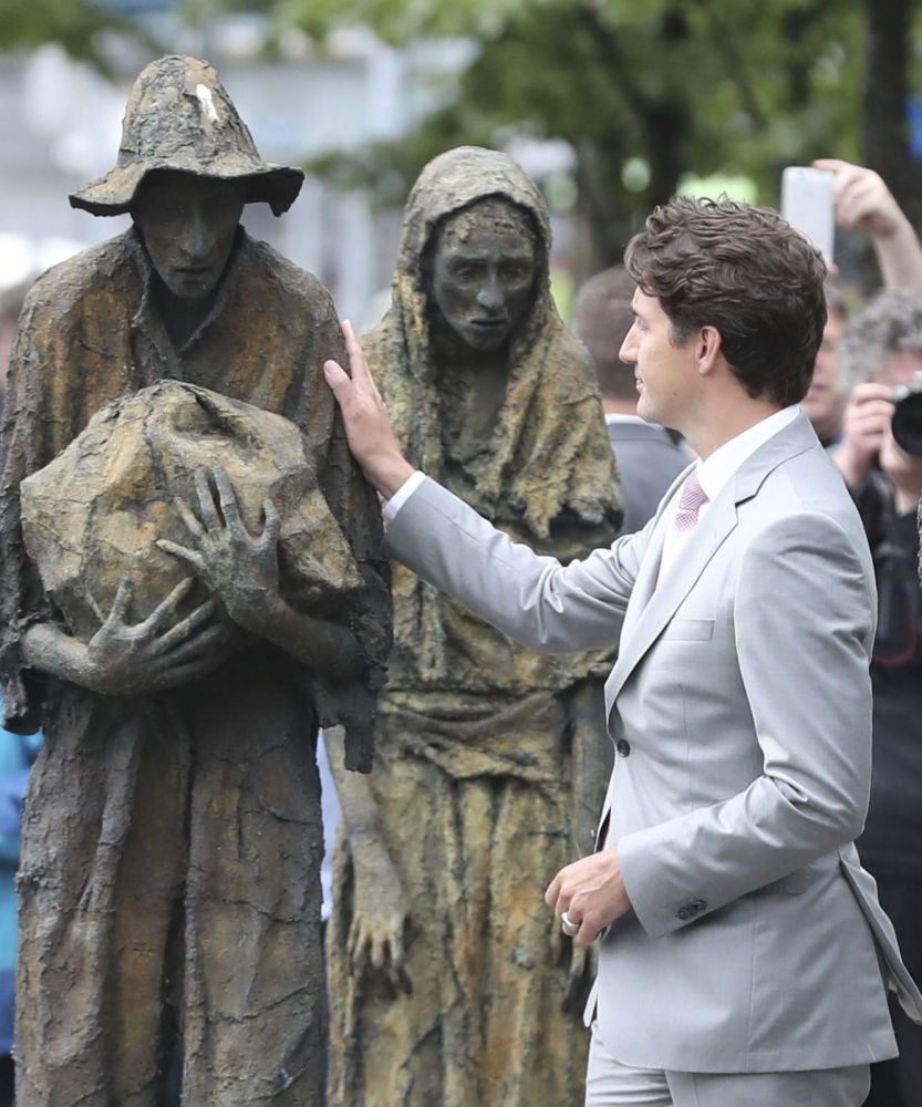Canadian Prime Minister Justin Trudeau views the Famine Memorial statues Tuesday in Dublin, Ireland. An online petition has been started to chastise Trudeau for his government's apparent plan to pay millions to the alleged killer of a U.S. soldier in Afghanistan.