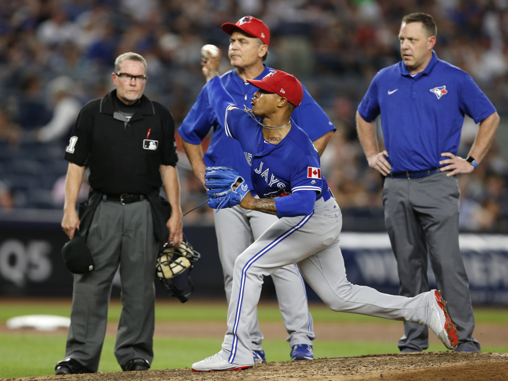 Blue Jays righty Marcus Stroman, center, was removed from his start against the Yankees after 79 pitches Monday because of a developing blister, a common injury this season.