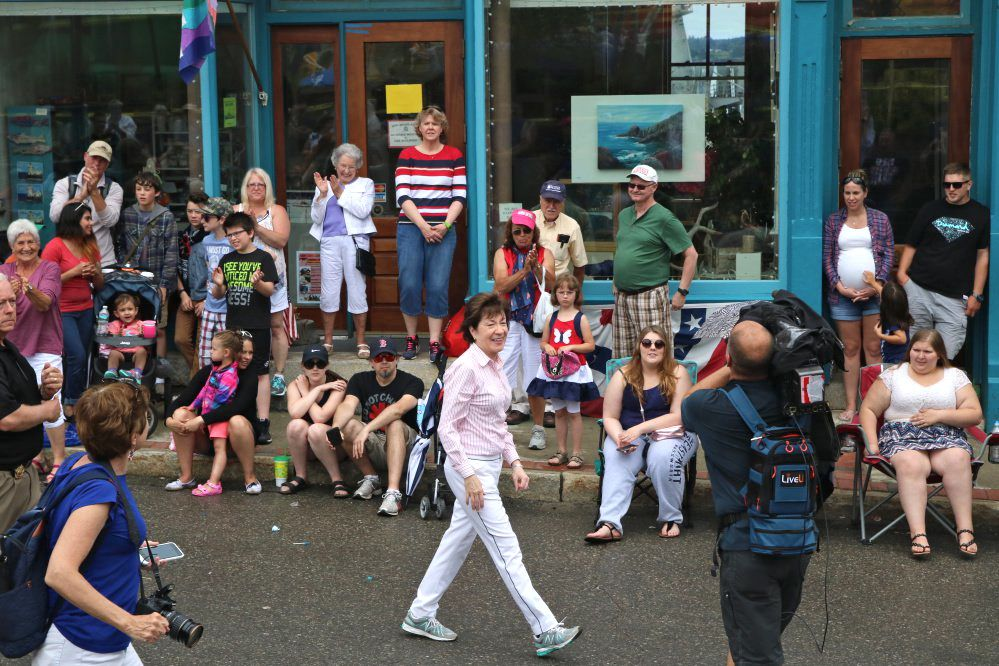 "Sen. Susan Collins, R-Maine, marches in Eastport's parade Tuesday. ""There was only one issue,"" she said, of her constituents' focus on health care."