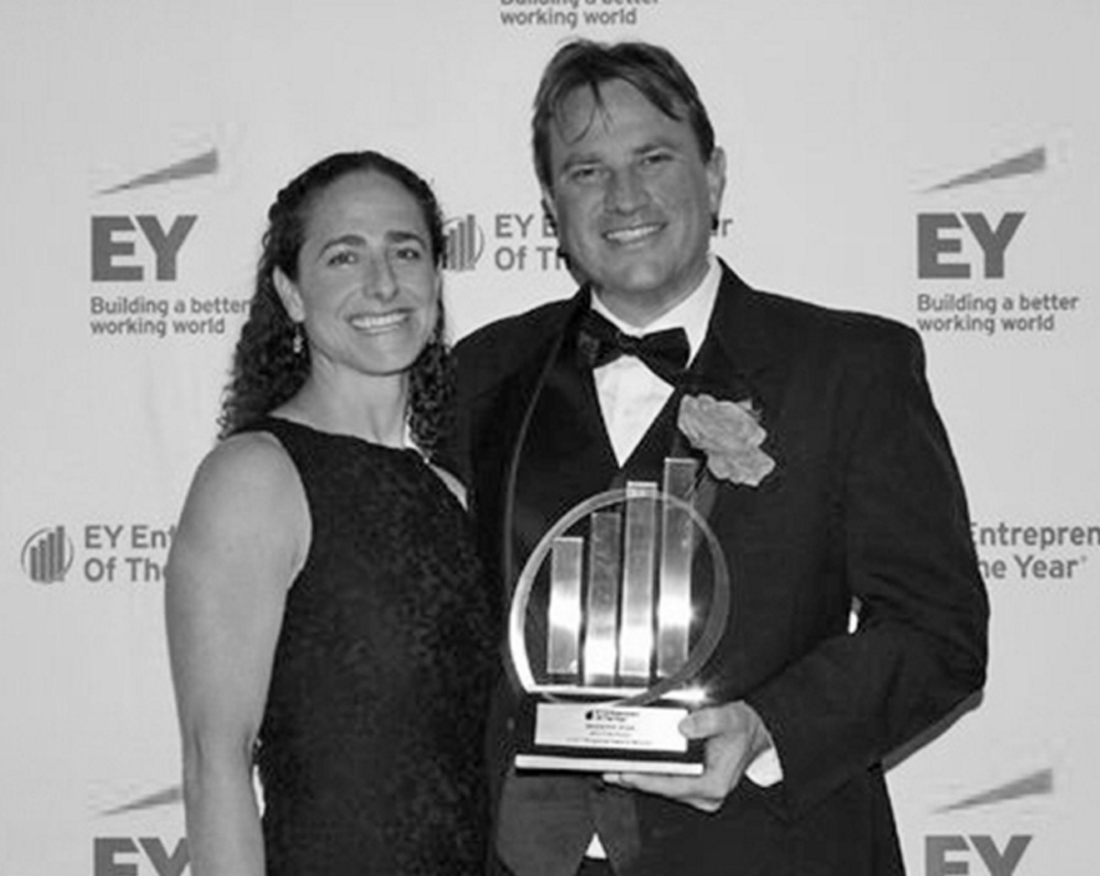 Entrepreneur award winner Ben Shaw and his wife, Bernadette, enjoy the moment at an Ernst & Young event.