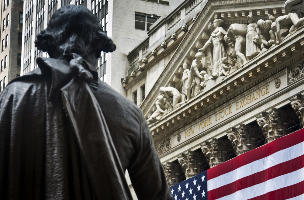 A statue of George Washington stands at Federal Hall near the flag-covered pillars of the New York Stock Exchange, in New York. Trading was subdued after the U.S. Independence Day holiday and ahead of the summit of the Group of 20 industrial nations later in the week.