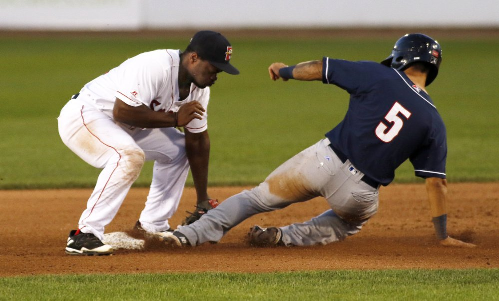 Sea Dogs infielder Josh Tobias tags out New Hampshire's Tim Lopez in Wednesday night's game at Hadlock Field.
