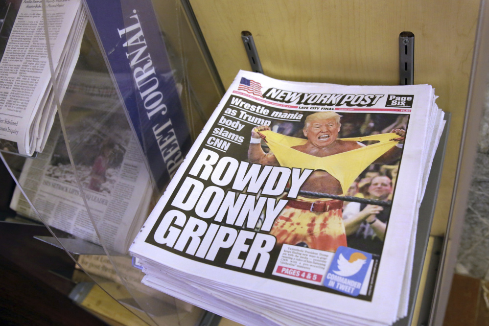 Copies of the New York Post with an illustration of President  Trump as a professional wrestler on the front page are displayed Monday at a newsstand in New York City.