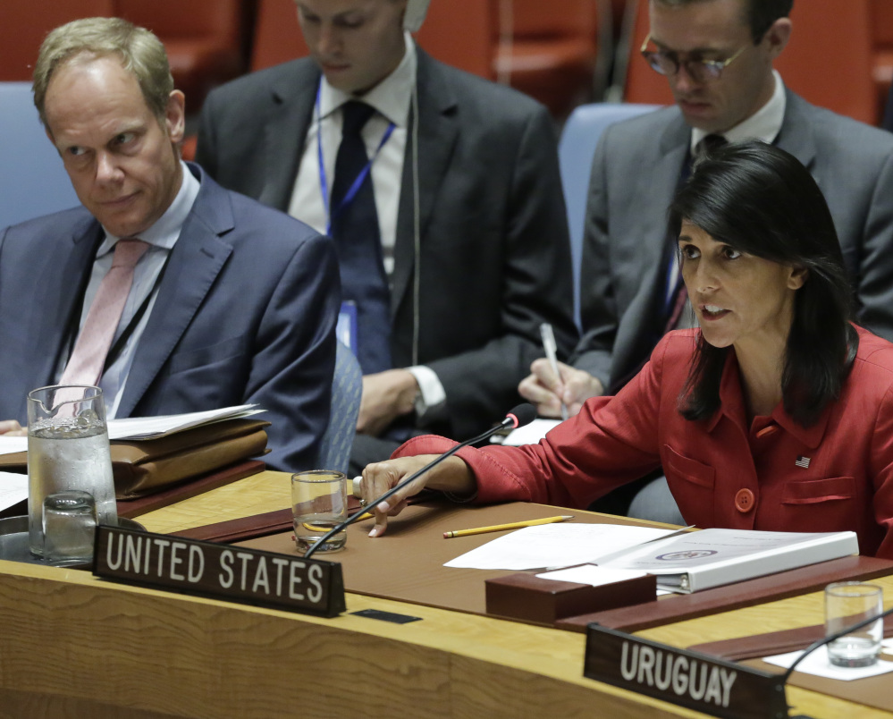 United Kingdom U.N. Ambassador Matthew Rycroft, left, listens as United States U.N. Ambassador Nikki Haley responds harshly to Russia's statements, during the U.N. Security Council meeting Wednesday.