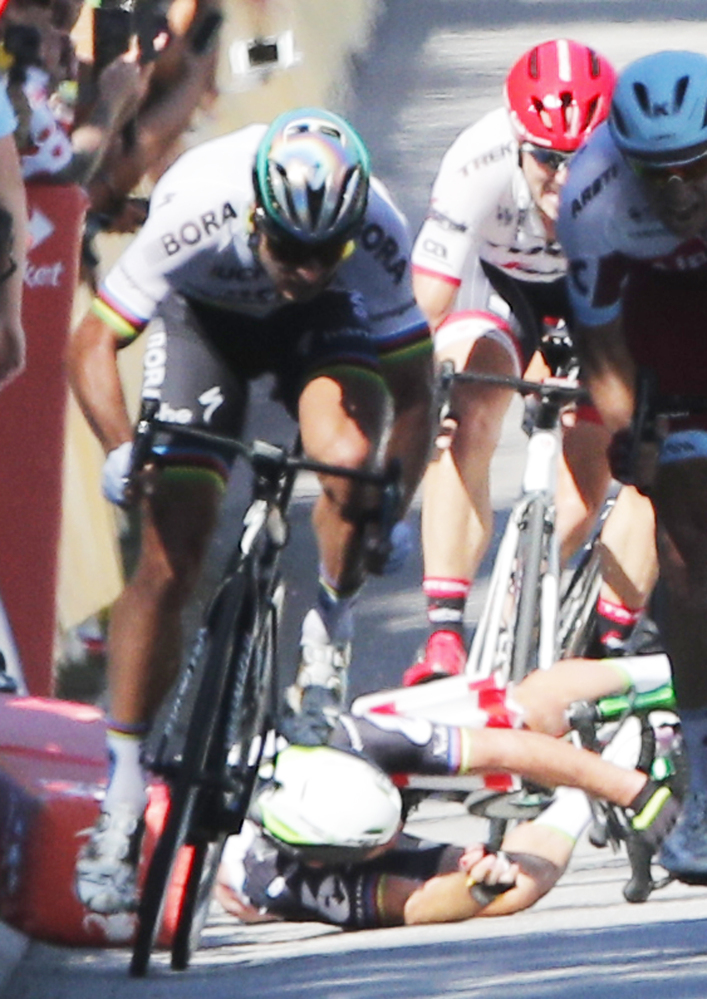 Peter Sagan of Slovakia sprints as Britain's Mark Cavendish crashes.