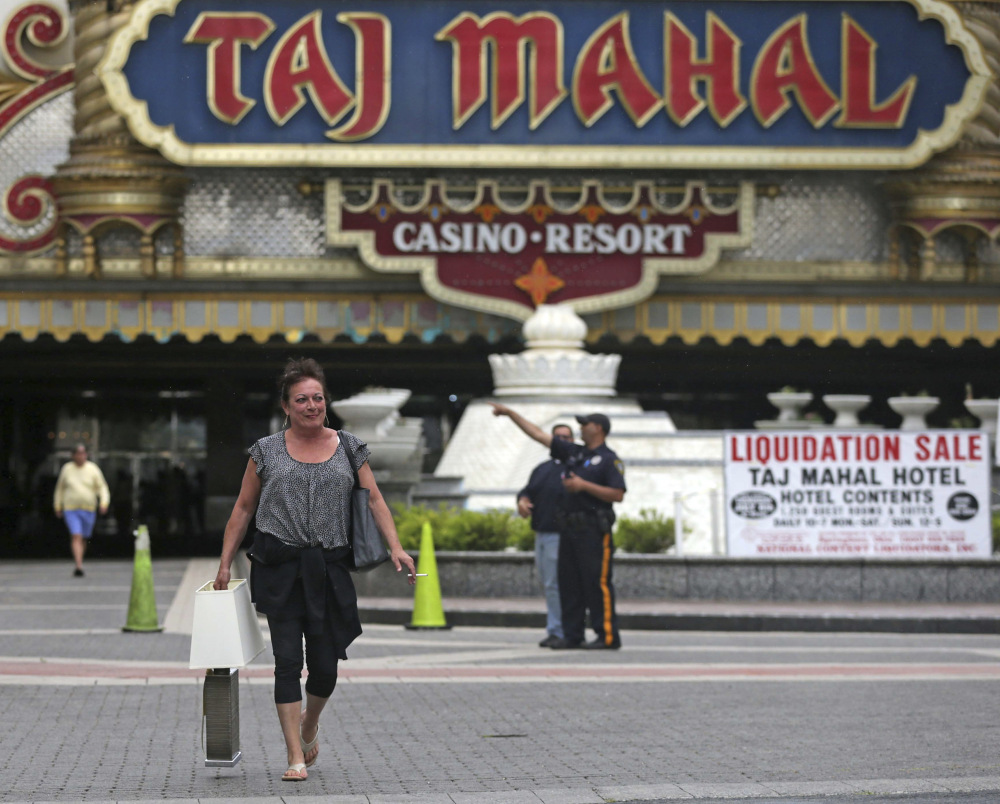 Patty Johnston of Atlantic City, N.J., leaves the Taj Mahal Thursday after buying a ceramic lamp and a flat-screen television. Hundreds of people swarmed the lobby looking for deals on fancy stuff.