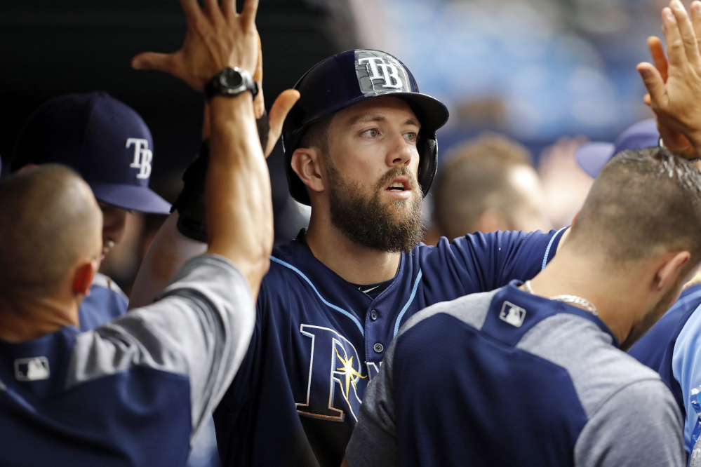Tampa Bay's Steven Souza Jr. is congratulated after scoring the only run of the game in the second inning on Saturday against the Red Sox in St. Petersburg, Fla. Tampa Bay beat Boston, 1-0. (Associated Press/Mike Carlson)
