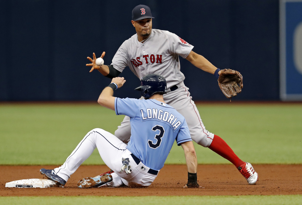 Boston shortstop Xander Bogaerts bobbles the exchange after forcing out Tampa Bay's Evan Longoria during the Rays' 5-3 win Sunday in St. Petersburg, Florida.