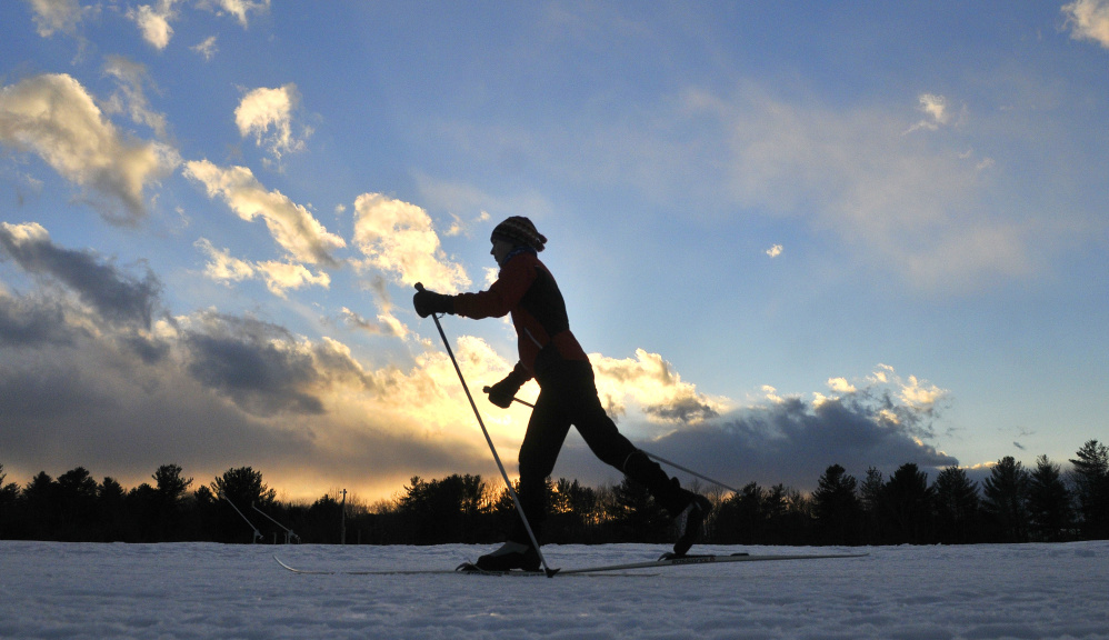 Jesse Hamilton, of Waterville, skis by headlamp at Quarry Road Recreation Area. The park has more than 6 miles of Nordic skiing trails and additional miles for snowshoeing and hiking.