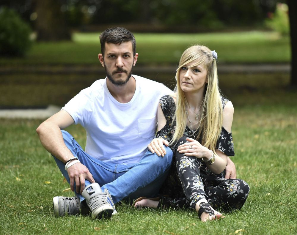 Parents of Charlie Gard, Connie Yates and Chris Gard, pose ahead of delivering a petition with more than 350,000 signatures to the hospital in London on Sunday. Dominic Lipinski/PA via AP