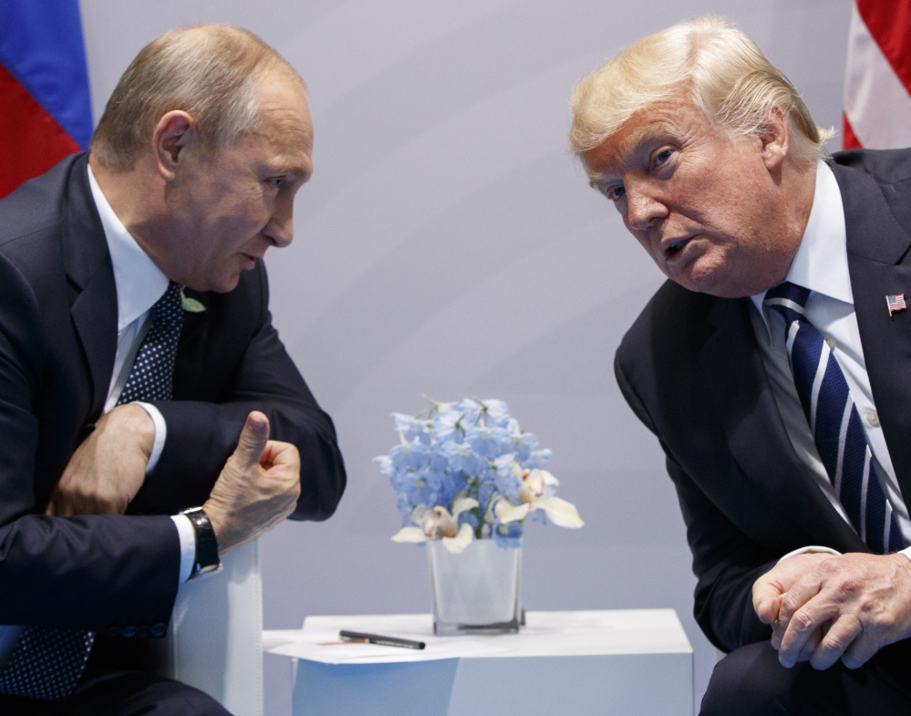 "At their July 2017 meeting at the G20 conference in Hamburg, President Trump says he ""strongly pressed"" Russian President Vladimir Putin twice about meddling in the 2016 U.S. presidential election, but he didn't say whether he believed Putin's denial."