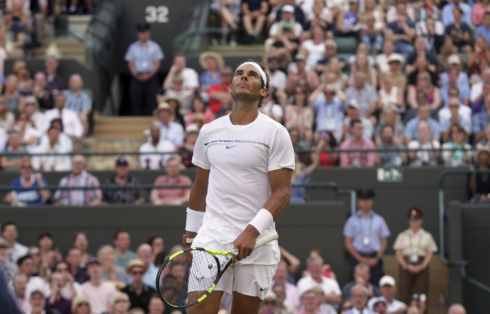 Spain's Rafael Nadal looks up as he plays Luxembourg's Gilles Muller during their fourth-round match at the Wimbledon Tennis Championships in London on Monday. Muller won the match 6-3, 6-4, 3-6, 4-6, 15-13 (AP Photo/Tim Ireland)