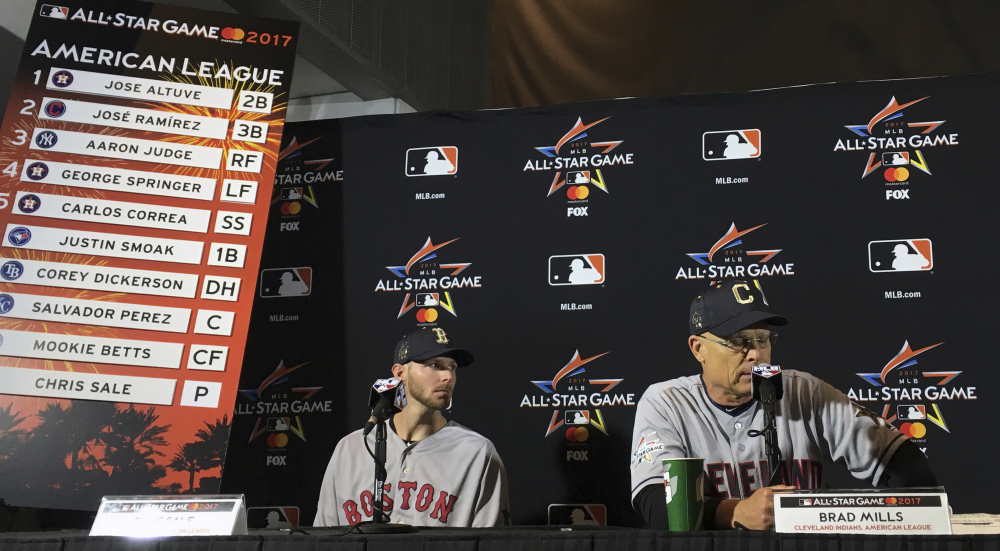 American League All-Star Game starting pitcher Chris Sale, left, looks on as AL manager Brad Mills speaks during a press conference for the All-Star game in Miami on Monday.