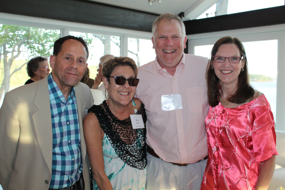 Host Committee members Neil Kurzmann and Eve Nelson of Portland enjoy a moment with festival supporters Dr. Fred Aronson and Elizabeth Israel.