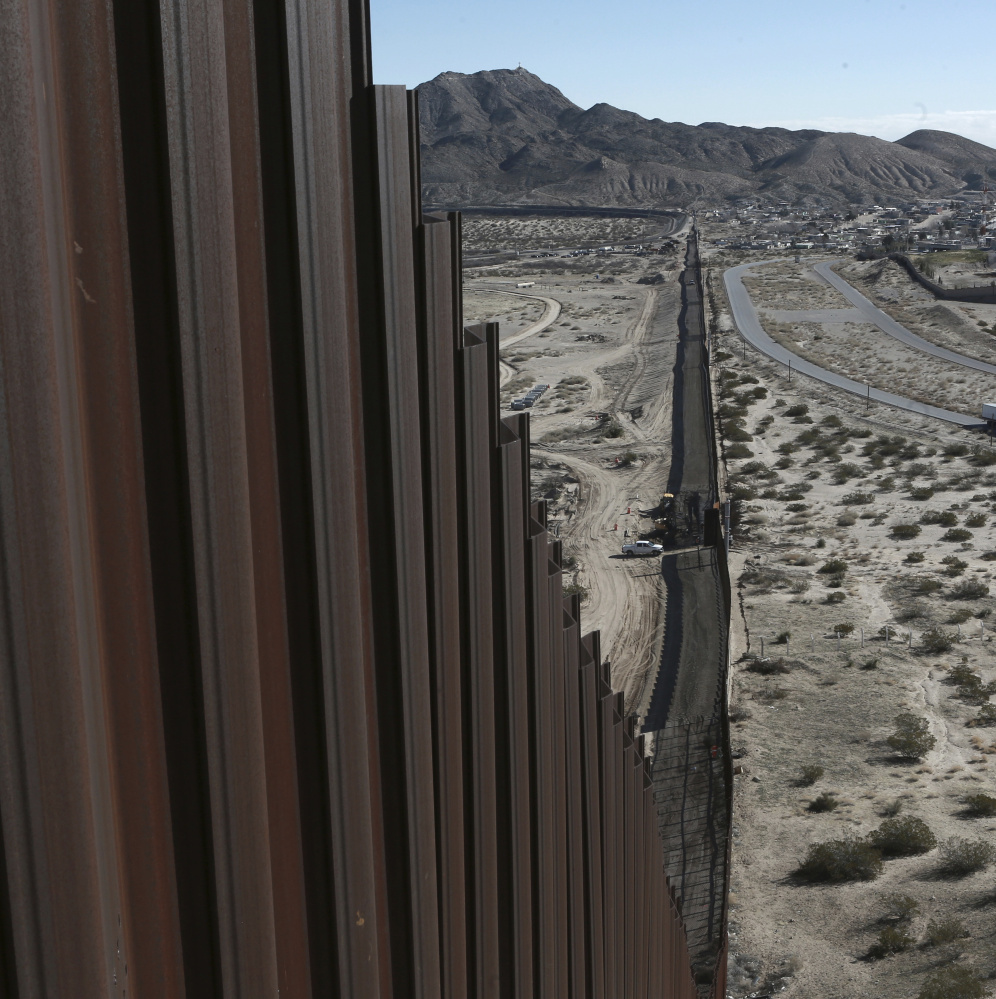Part of the current Mexico-U.S. border fence disappears into the horizon in Sunland Park, New Mexico.