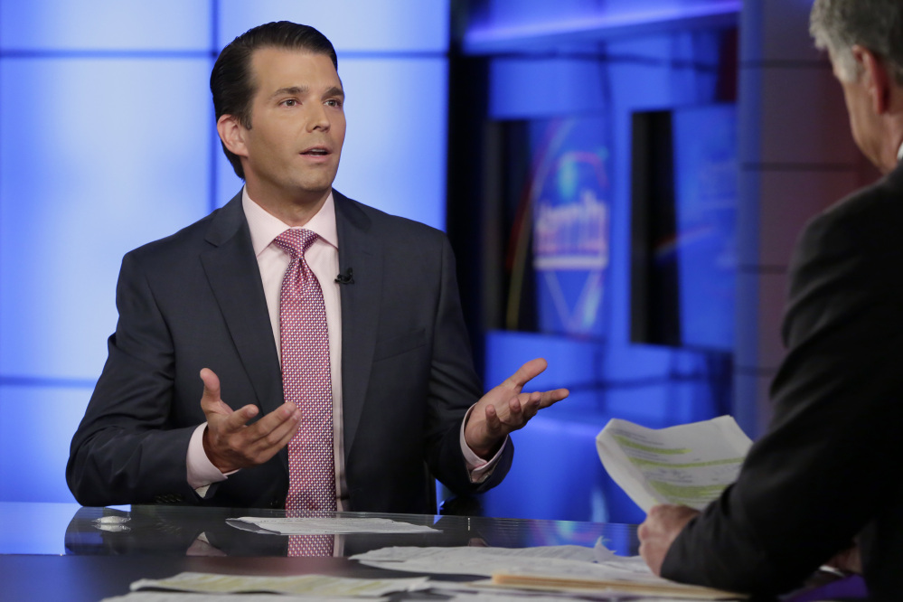 Donald Trump Jr., left, is interviewed by host Sean Hannity on his Fox News Channel television program, in New York. Donald Trump Jr. eagerly accepted help from what was described to him as a Russian government effort to aid his father's campaign with damaging information about Hillary Clinton, according to emails he released publicly on Tuesday.