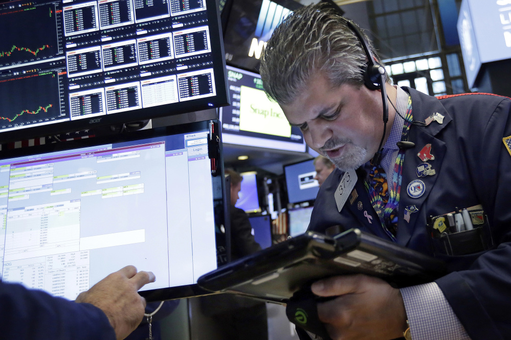 Trader John Panin works on the floor of the New York Stock Exchange, Wednesday, July 12, 2017. Stocks are opening solidly higher on Wall Street, led by gains in technology companies. ()