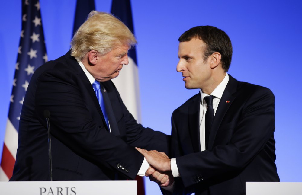 President Trump and French President Emmanuel Macron end a news conference in July in Paris.