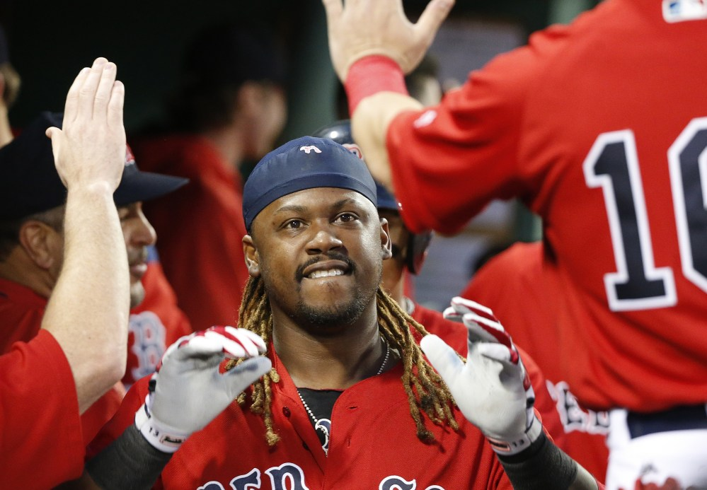 Boston's Hanley Ramirez celebrates his two-run home run in the third inning Friday night against the New York Yankees at Fenway Park.