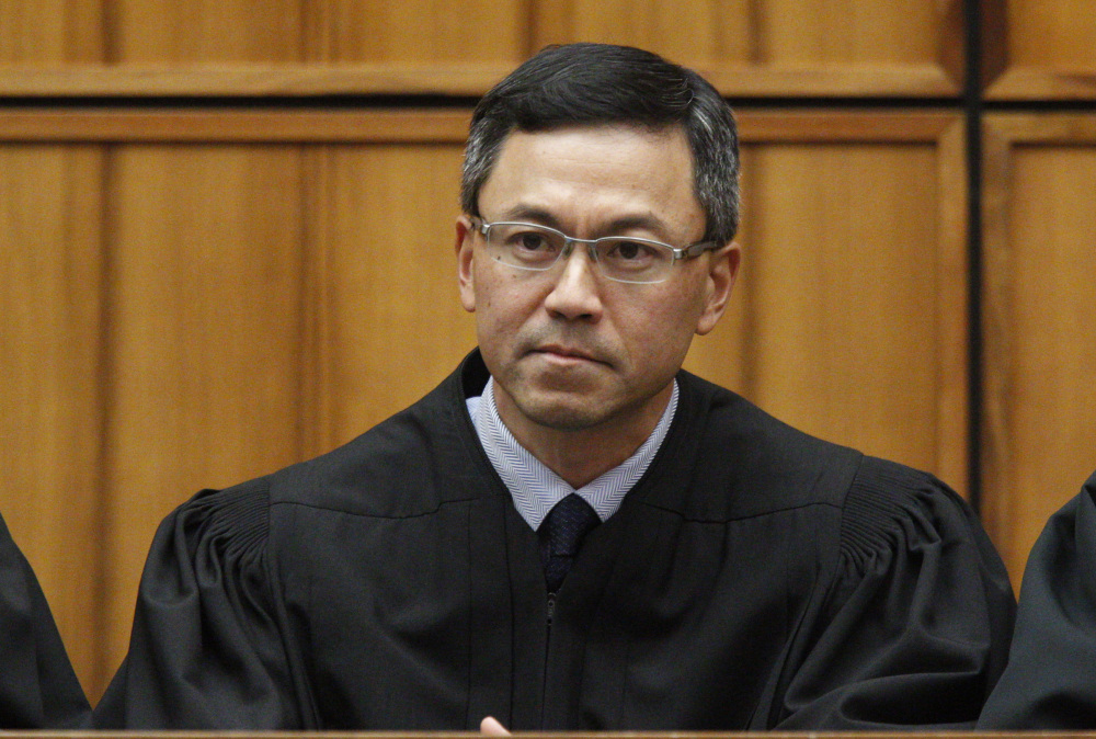 U.S. District Judge Derrick Watson expanded the list of relationships that allow entry to the United States.