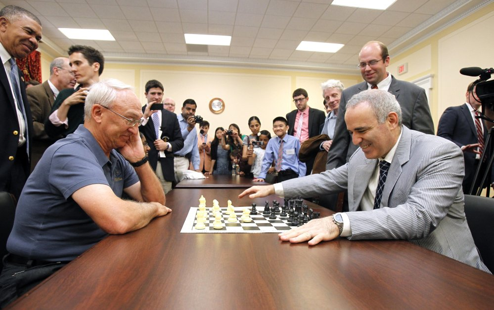 Garry Kasparov, right, and Rex Sinquefield, president of the Board of Directors of the St. Louis Chess Club, play at the Congressional Chess Match of 2014 in Washington.