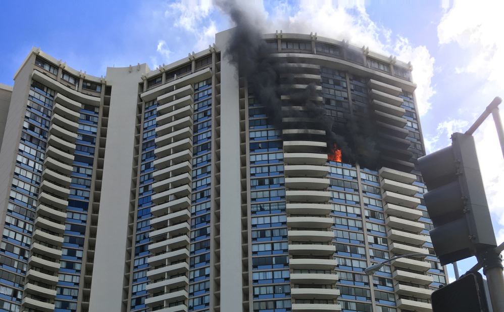 At least three people died in a fire Friday at this apartment complex in Honolulu. It