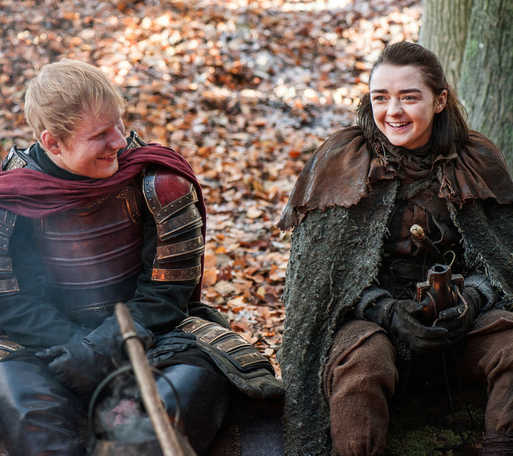 "Ed Sheeran, left, and Maisie Williams appear in a scene from ""Game of Thrones."" Sheeran played a soldier leading a group in song in the season premiere of the HBO drama."