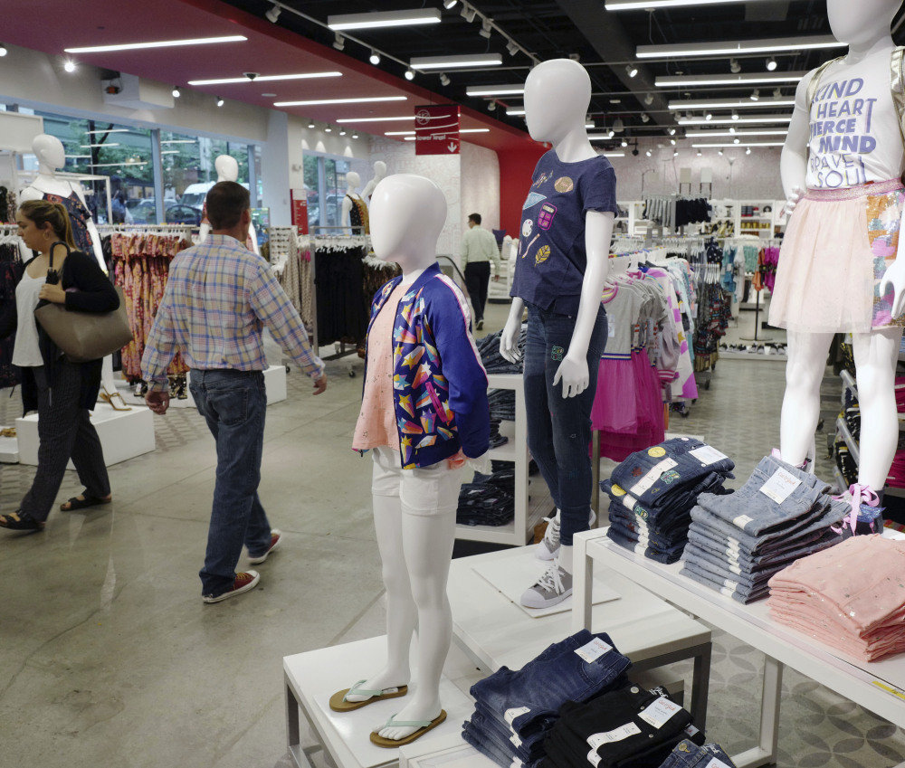 Cat & Jack jeans and tops, made with Repreve polyester fabric created from recycled plastic bottles, are shown on display at a Target store in New York on Friday.