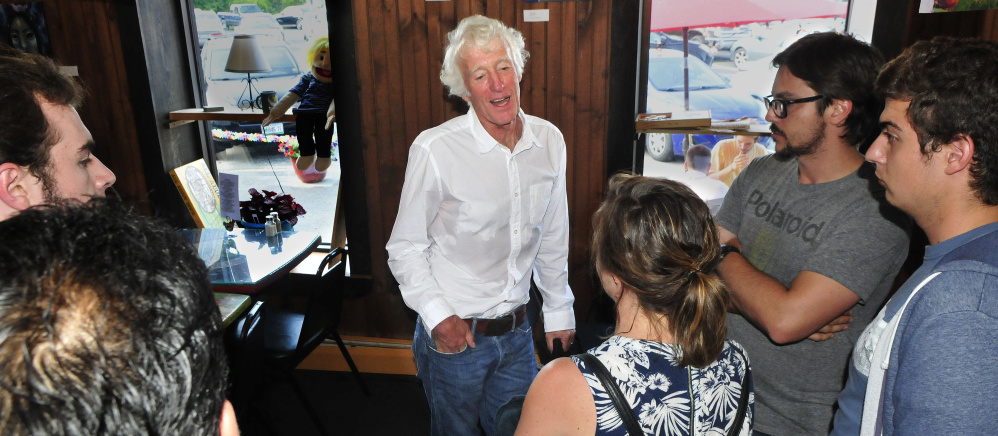 Cinematographer Roger Deakins talks with film fans at Grand Central Cafe in Waterville, after a Maine International Film Festival screening Monday.