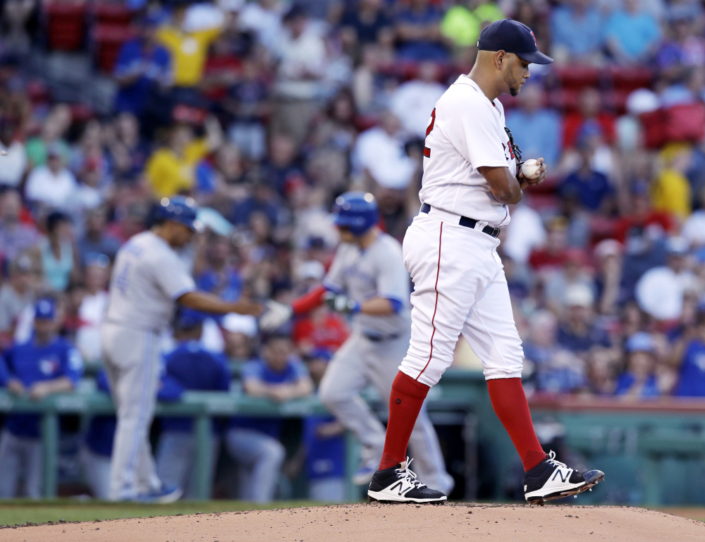 Red Sox starter Eduardo Rodriguez walks to the mound with a fresh baseball as the Blue Jays' Steve Pearce rounds the bases on a solo home run in the second inning. It was the last run that Rodriguez gave up.