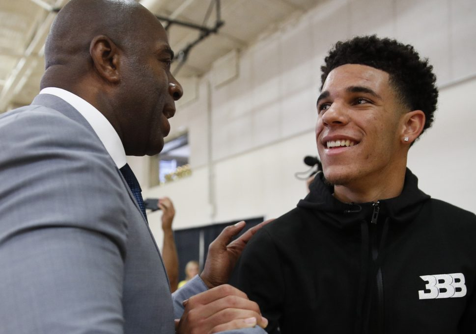 Magic Johnson, left, wants some of the pressure off rookie Lonzo Ball, right, saying the team is not about him. But for fans at the summer league, it is all about Ball. Period.