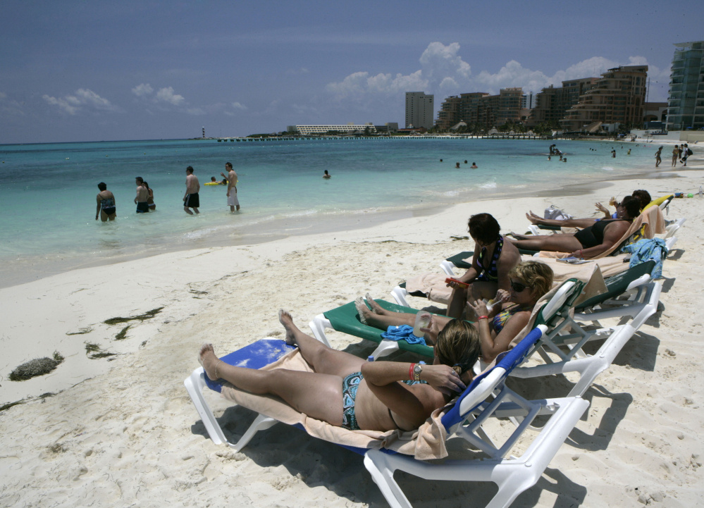 Tourists soak up the sun in Cancun, Mexico. The job market in Mexico is strong this year, and tourism is a factor.