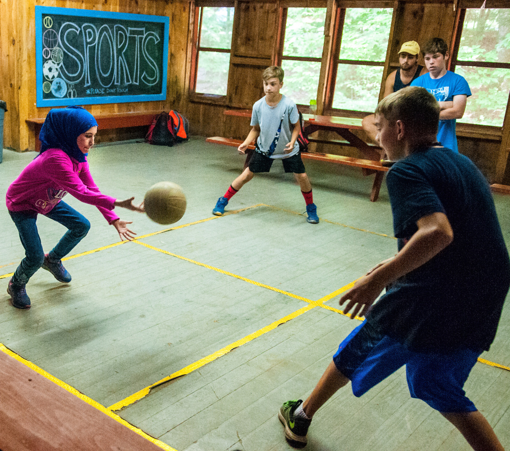 Ghadeer Najar plays four square Wednesday at Camp KV in Readfield. Fifteen refugee children from the Augusta area have been able to participate in the summer fun.