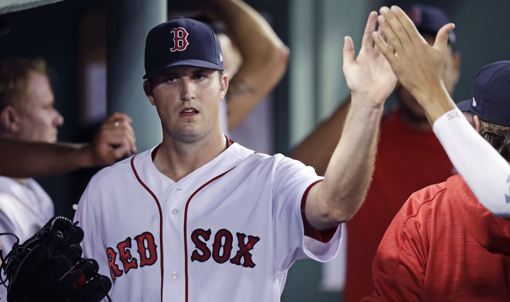 Red Sox starter Drew Pomeranz is congratulated in the dugout after being taken out of the game in the seventh inning Wednesday night at Fenway Park. Pomeranz pitched 6   innings and did not allow an earned run to win his 10th game.