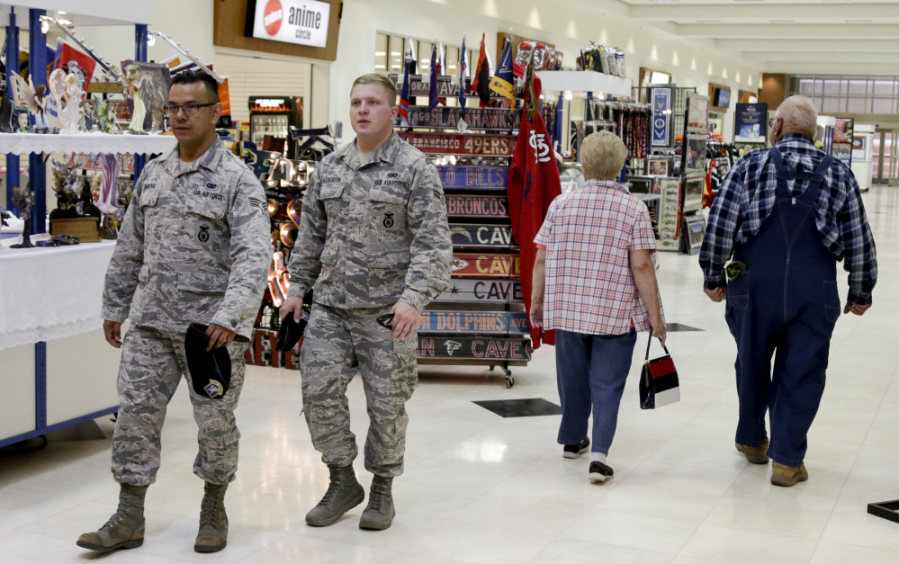 Members of the military and civilians with shopping privileges walk through the Exchange at Offutt Air Force Base, Neb. Starting in the fall, honorably discharged veterans will be able to shop tax-free online at the Exchange with the same discounts they enjoyed at base stores.