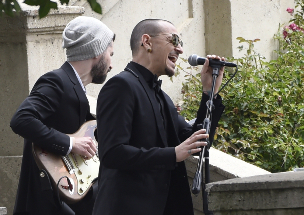 "Chester Bennington, of Linkin Park, performs ""Hallelujah"" at a funeral for Soundgarden singer Chris Cornell at the Hollywood Forever Cemetery in Los Angeles in May. Like Cornell, Bennington died by hanging, the coroner says."