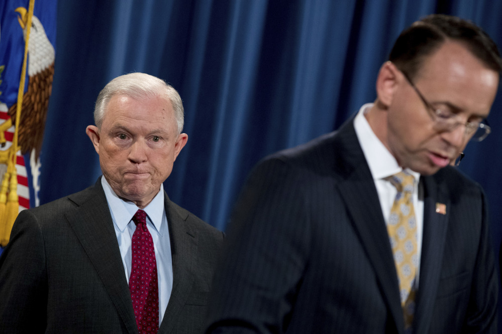 Attorney General Jeff Sessions, left, shown with Deputy Attorney General Rod Rosenstein, talked about the Trump campaign with the Russian Ambassador Sergei Sislyak, intelligence intercepts of Sislyak's communications show. The sources noted that Sislyak could have mischaracterized the interactions in his reports to his bosses.