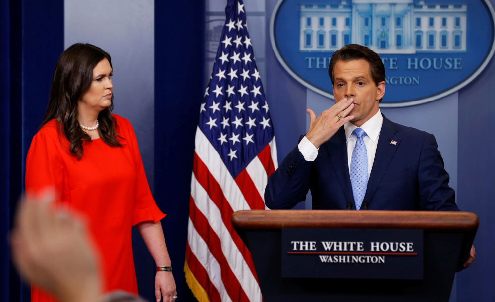 New White House communications director Anthony Scaramucci, blows a kiss to reporters while press secretary Sarah Huckabee Sanders looks on during the daily press briefing Friday.