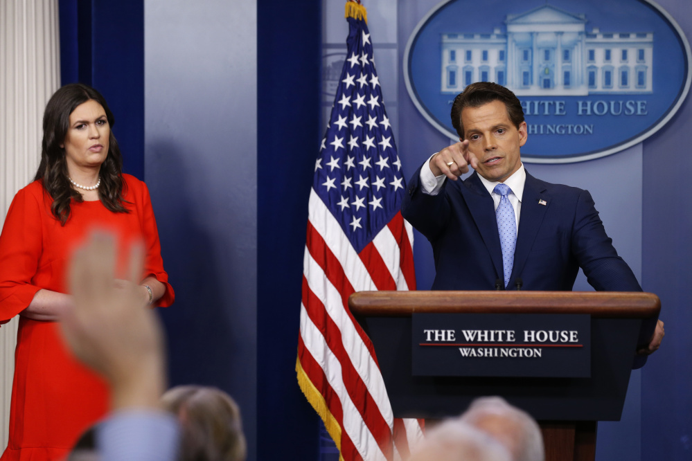 New White House Communications Director Anthony Scaramucci, flanked by White House Press Secretary Sarah Sanders, takes questions at the daily briefing at the White House in Washington, U.S. July 21, 2017. REUTERS/Jonathan Ernst - RTX3CG4J