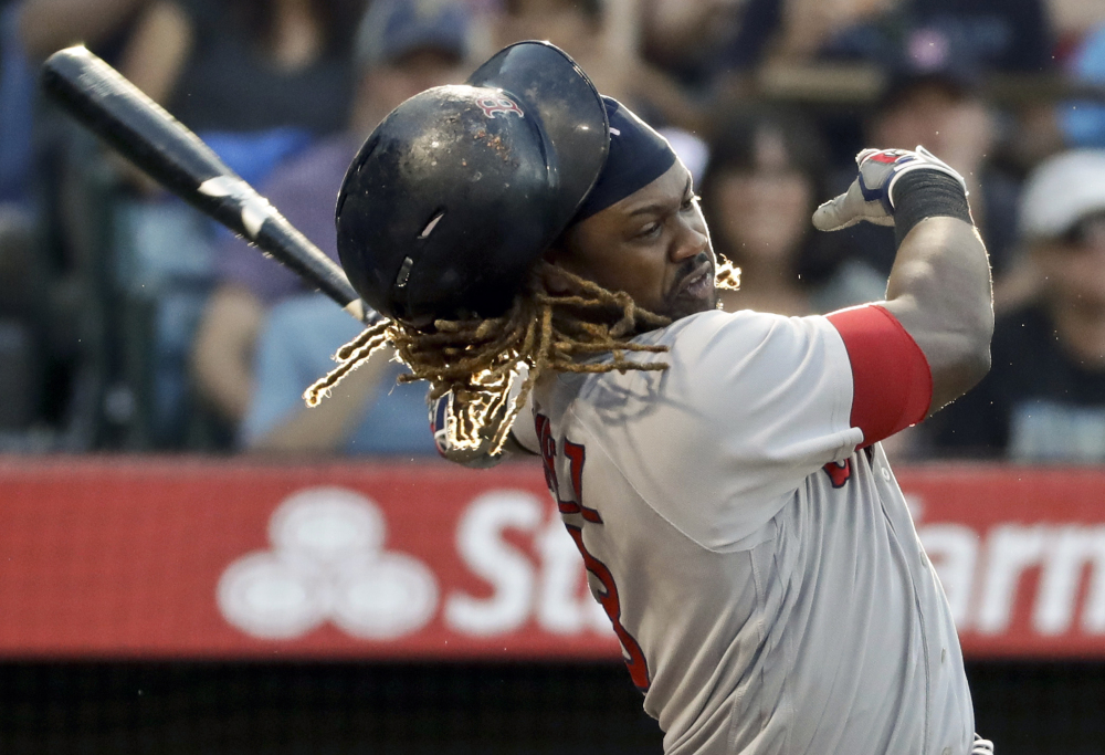 Hanley Ramirez loses his helmet while swinging during the Red Sox 7-3 loss at Anaheim on Saturday night.