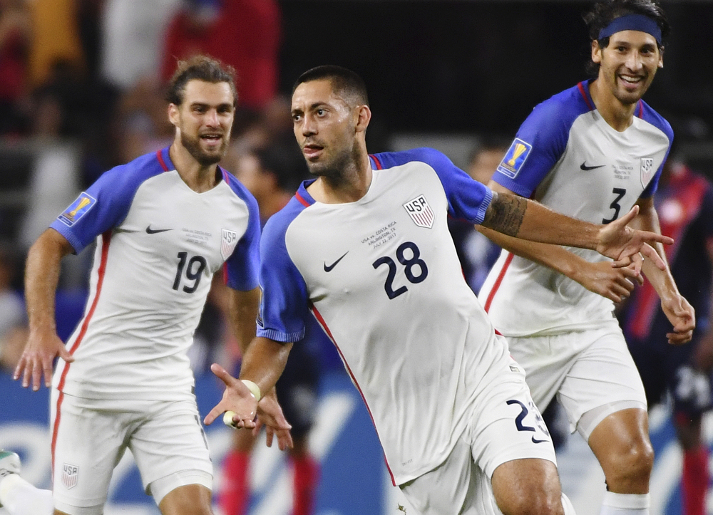 Clint Dempsey celebrates with teammates Graham Zusi, left, and Omar Gonzalez after scoring a goal during a CONCACAF Gold Cup semifinal soccer match against Costa Rica on Saturday night. The U.S. won 2-0 to advance to the Gold Cup finals.