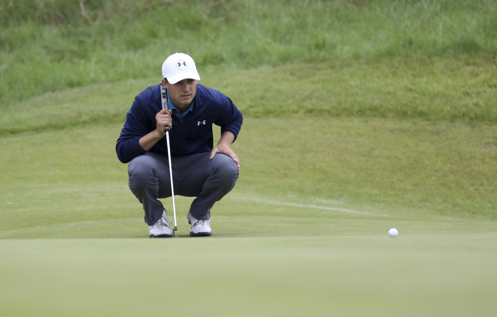 Jordan Spieth lines up a putt on the 14th green during the final round of the British Open on Sunday. Spieth won his first open with a 12-under score for the tournament.