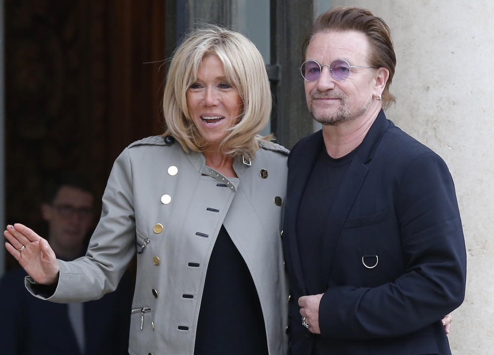 Brigitte Macron, the French first lady, and U2 singer and activist Bono pose at the Elysee Palace in Paris on Monday. The education of girls and women in Africa was discussed.