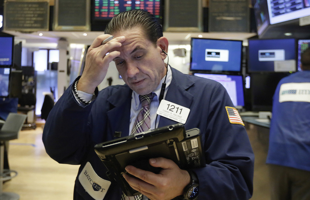 Tommy Kalikas works on the floor of the New York Stock Exchange on Monday. Over a third of S&P 500 companies are due to release their second-quarter result in coming days, and the Federal Reserve's policymaking committee begins a two-day meeting Tuesday.